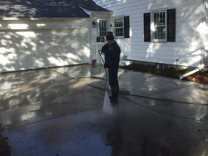 man cleaning driveway